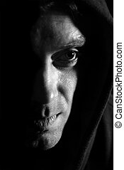 Hooded shadowed man black and white image