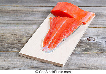 Fresh Salmon fillet ready to cook - Closeup horizontal front...