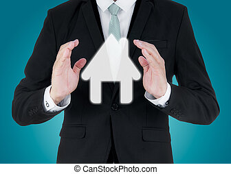 Businessman standing posture hand holding house icon...