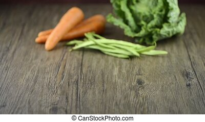 Carrots and green beans - Bunch of fresh xarrots and green...
