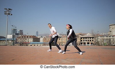 Professional dancers dancing in the street of Sarajevo,...