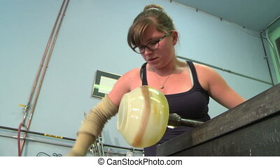 Glassblower shaping vase 7 - Low angle shot of glassblower...