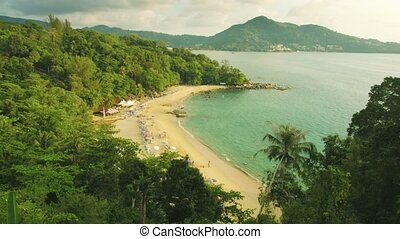 Top view of a tropical beach with tourists. Thailand, Phuket, Kamala