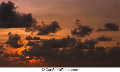 The sun sets in the cloud. Timelapse in orange tones - Video...