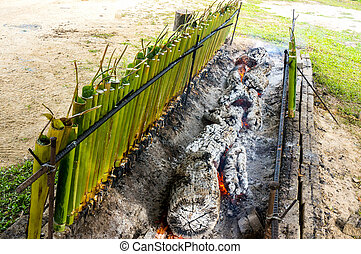 "traditional Malay food, ""lemang"" - A row of traditional..."