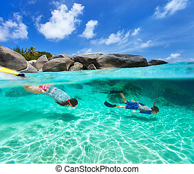 Family snorkeling in tropical water - Split photo of mother...