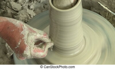 Potter shaping top of vase 6 - Potter shaping a vase on the...