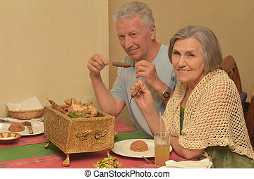 Senior couple having a dinner at restaurant