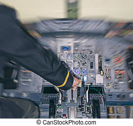 Rear view of pilot in aircraft cabin. Motion effect.