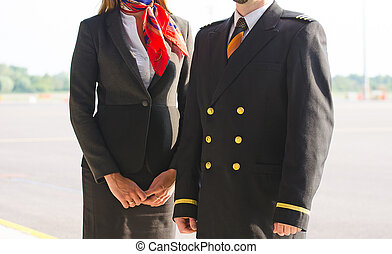 Pilot and stewardess on the airfield