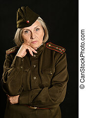 Mature female soldier on a black background