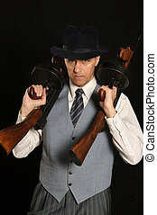 Gangster man in suit with gun - Handsome gangster man in...