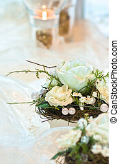 Festive table decoration in creamy white hues