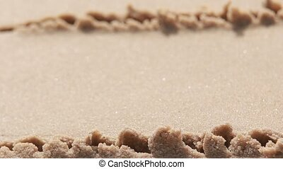 yellow sand and water - Sand beach and sea foam macro with...