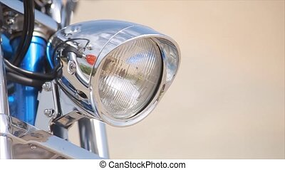 Custom motorcycle - a dark blue motor cycle is in the daily...