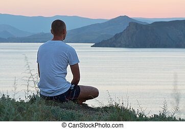 Man looks at the sunset