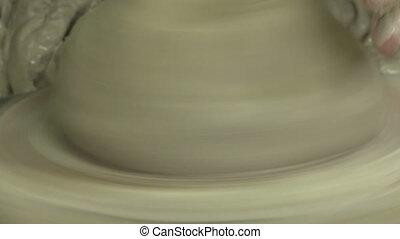 Potter starting a vase 2 - Close up of potter's fingers...