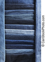 Denim jeans fabric background made of different blue fabrics