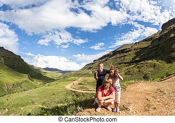 Family Mountain Hike - A family poses together in the...