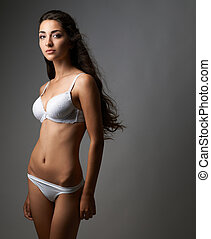 beautiful lady in lingerie on gray background - elegant lady...