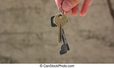 holding keys - metal key from house