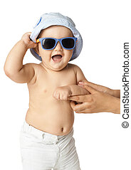baby in panama and sunglasses laughing on white background