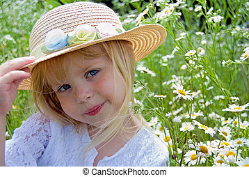 Country Style - Cute blond girl with a summer hat