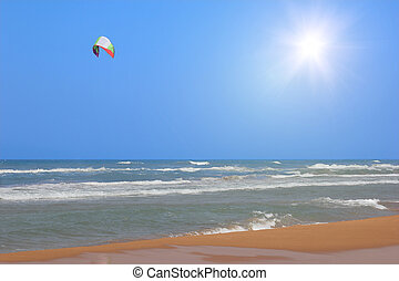 Sea and sun - A kite over the sea on a sunny day