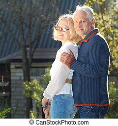 Elderly couple in love. Beautiful elderly couple gently...