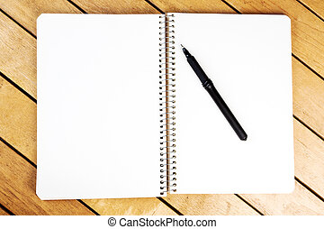 Blank notepad with black pen
