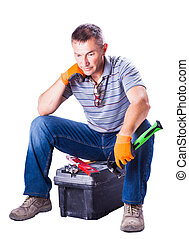 worker is resting sitting on toolbox