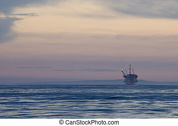 offshore oil rig - off shore oil drilling rig at sunset