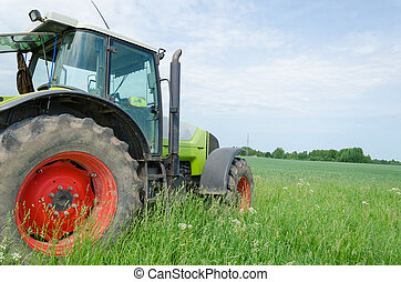 field work tractor in meadow - season of field work heavy...