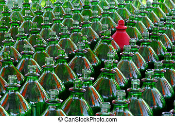 Ring toss bottles - one red bottle in a group of green ring...