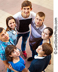 Group of smiling teenagers standing outdoors