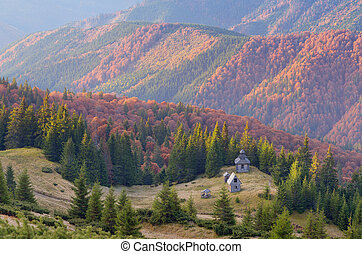 Wooden church in the mountains - Autumn landscape with old...