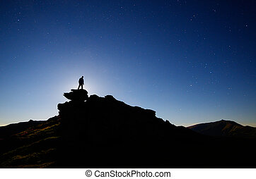 Man stands on a rock