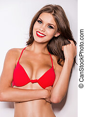 Gorgeous beauty Beautiful young brown hair woman in red...