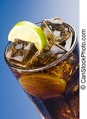 refreshing glass of cola with lemon and ice