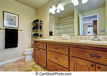 Bathroom wtih wooden vanity cabinet and mirror - Bathroom...