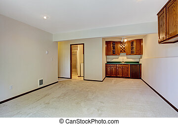Empty room with kitchen cabinets