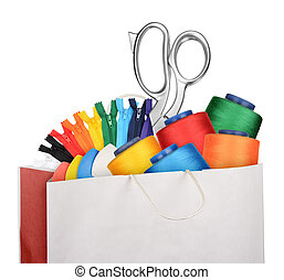 Sewing supplies - Shopping bag with sewing supplies isolated...