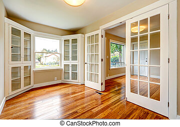 Empty house interior. View of entrance hallway and office...