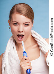 Girl singing to toothbrush. Dental teeth care.