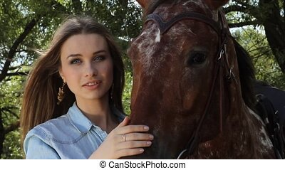 woman embrace brown horse outdoors