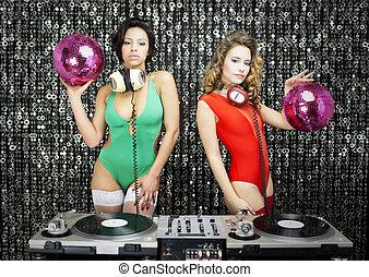 two beautiful sexy disco dj women in bikinis performing in a...