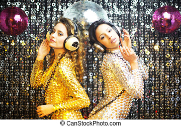 two beautiful sexy disco women in gold and silver catsuits...