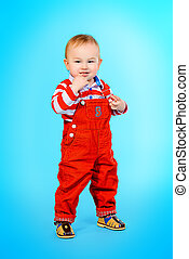 toddler - Full length portrait of a cute baby boy learning...