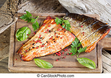 Freshly Smoked Salmon in natural wooden setting - Closeup...