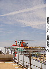Coast Guard Jayhawk Rescue Helicopter - A white and orange...